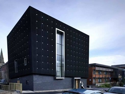 Three-storeys Soundhouse Enveloped in Black Rubber