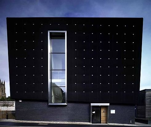 three storeys soundhouse enveloped in black rubber 3 Three storeys Soundhouse Enveloped in Black Rubber