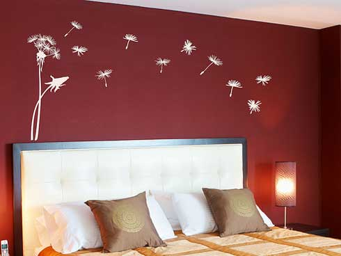 beautiful wall decal inspiration : dandelion seeds being blown
