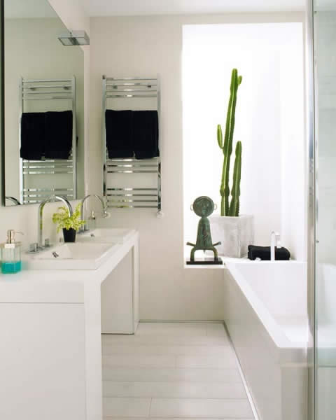 Scandinavian design bathroom with wall mount ceramic white