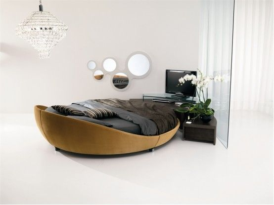 Luxury-round-bedroom-in-wooden-and-black-furniture-and-modern-chandelier