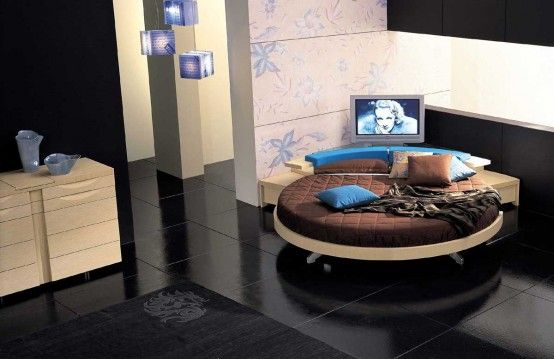 Modern-round-bedroom-in-brown-and-blue-elements-and-black-floor