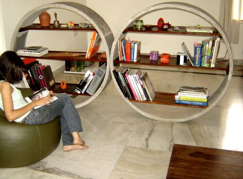 Unique Concrete Bookshelves Act as Room Dividers