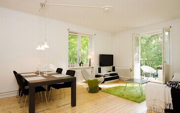 apartment with light wood floors painted white walls 1 554x3 White and Spacious Apartment in Stockholm