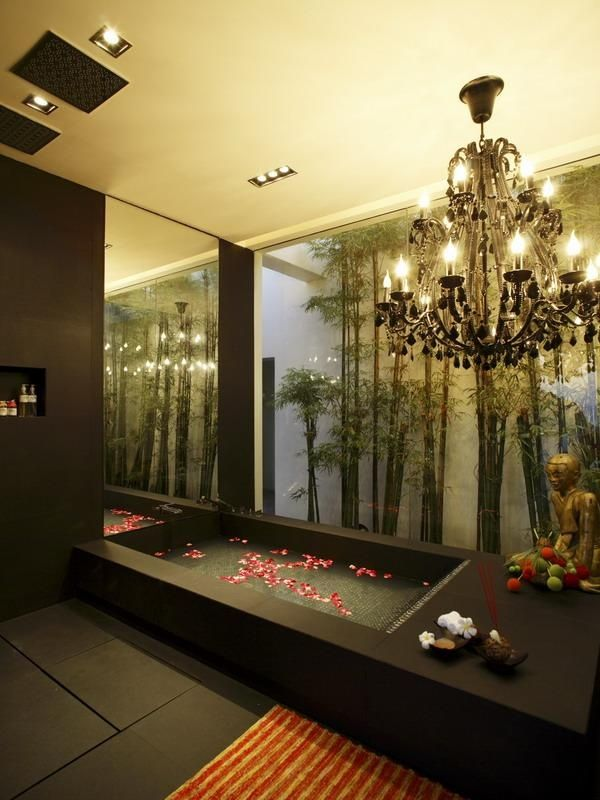 beautiful black bathtub with flower petals This Might Just Be the Best Looking Villa in Thailand