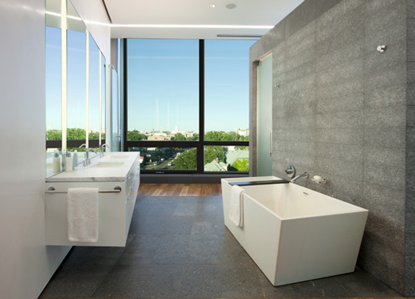 Luxury-amazing-bathroom-design-with-porcelain-bathtub-modern-shower-area-washbasin-with-cupboard-and-mirrors