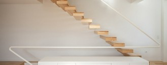 Refined Staircase Addition to a Minimalist Home by A+R Arquitectos