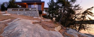 Charming Residence Emerging From Rock Formations: Cliff House
