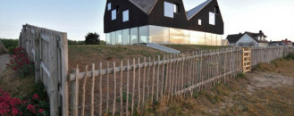 Floating Half Dark Half Transparent Dune House in England