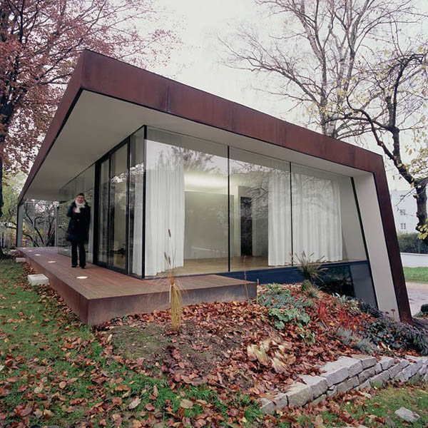 Revitalized 1920s Residence: Folded Corten House