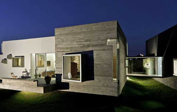 Residence and Artist's Studio Connected by a Glass Bridge