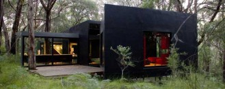 Dramatic Dark Red Hill Residence Displaying a Glass Skin