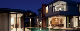 Brightly Colored Home Organized Around a Central Swimming Pool