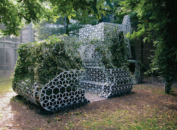Perforated Metal Installation Shaped As An Excavator