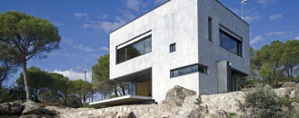 Small Concrete Home Near Madrid Displaying an Irregular Shape
