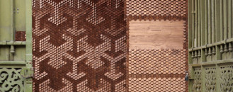 "Angled Walnut-Veneered ""Pixels"" Shaping A Light-Defined Installation"