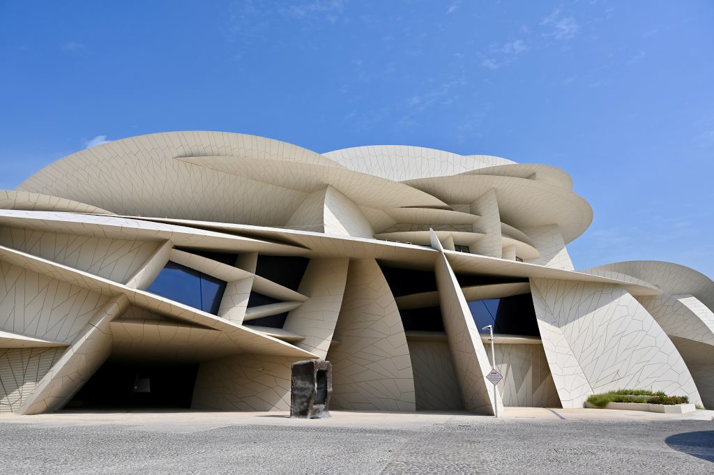 DOHA, QATAR - NOVEMBER 16: The National Museum of Qatar, designed by Jean Nouvel to look like the natural Desert Rose crystal that's found in Qatar, with inward-curving disks, intersections and cantilevered elements, opened on March 28th, 2019, with 1.5 kilometers of gallery space, giving voice to the unique story of Qatar and its people in an immersive and experiential manner in three chapters — Beginnings, Life in Qatar and The Modern History of Qatar on November 16, 2019 in Doha, Qatar. (Photo by Rubina A. Khan/Getty Images)