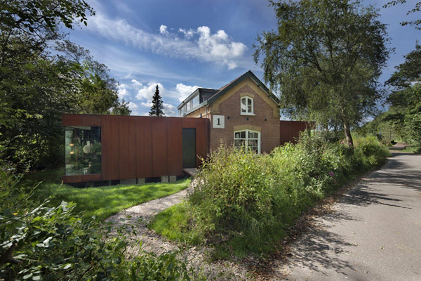 Modern Upgrade for an Impressive Historic Railway Cottage in The Netherlands