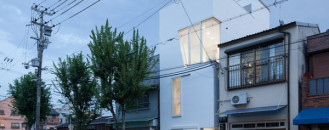 Hallow White Boxes And Generous Windows Defining Narrow Home in Osaka