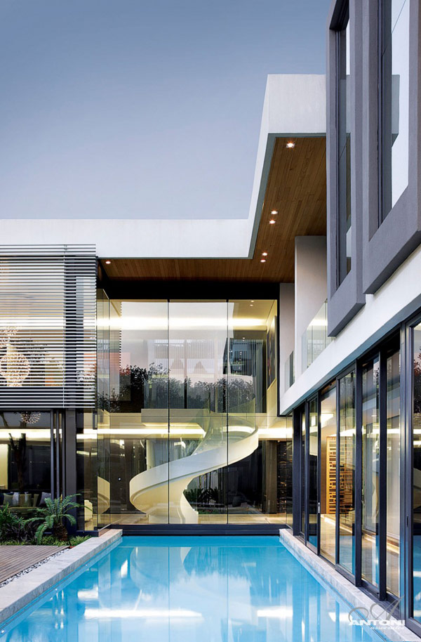 Beachfront Luxury Modern Home Exterior At Night: U-Shaped Modern Residence In Johannesburg Displaying Extravagant Features