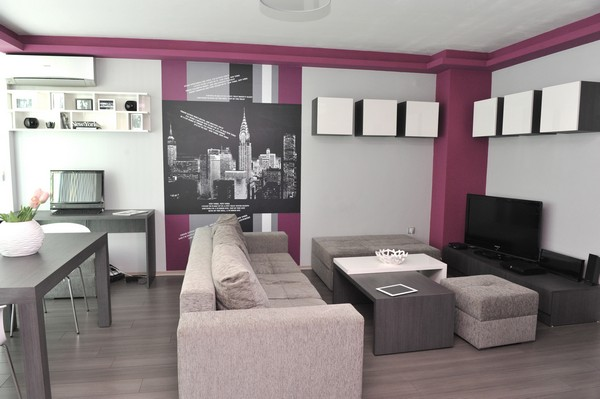 2 Tiny Apartment In Sofia With Wall Graphic Details This Look Canvas Couch Coffee Table