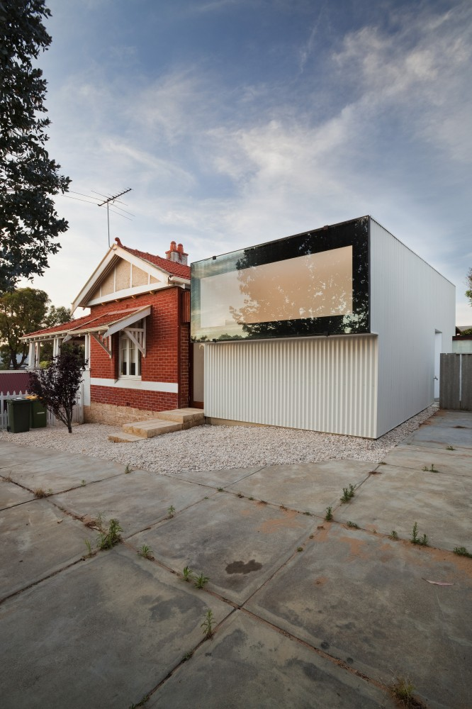 Modern And Compact Addition For A Traditional Brick House By David