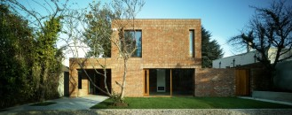 Renewed Home in Dublin Boasting Wooden Details And A Brick Fence