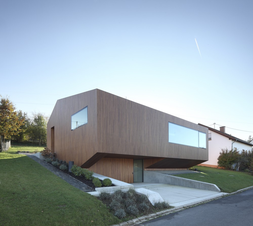 Contemporary Approach Minimalist House With Unusual Shape In