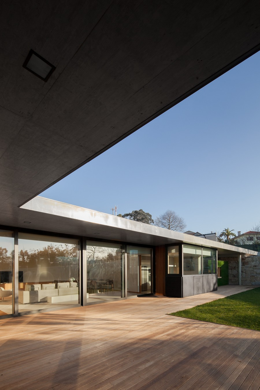 Black Concrete Building Displaying a Minimalist Architecture: House in Mosteiro