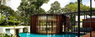 Modern House with Curvilinear Pavilion Blending in with the Natural Landscape
