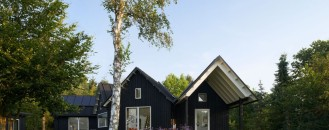 Rustic Village House Integrating Traditional Danish Elements by Powerhouse Company