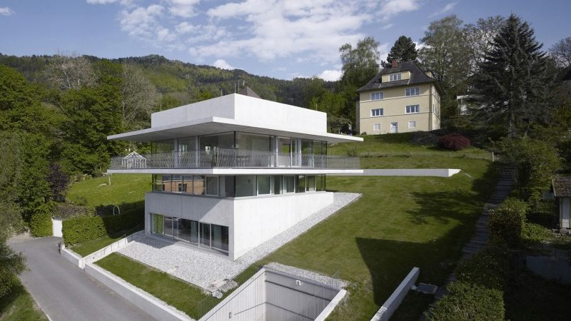 Partially Cut Into the Hillside: House by the Lake in Bregenz, Austria