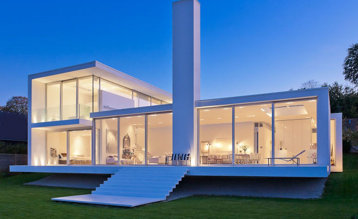 Distinct Villa by the Sea Floating on Green Surroundings