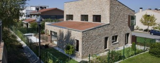 Traditional Family House Made of Sandstone: Project DG in Spain