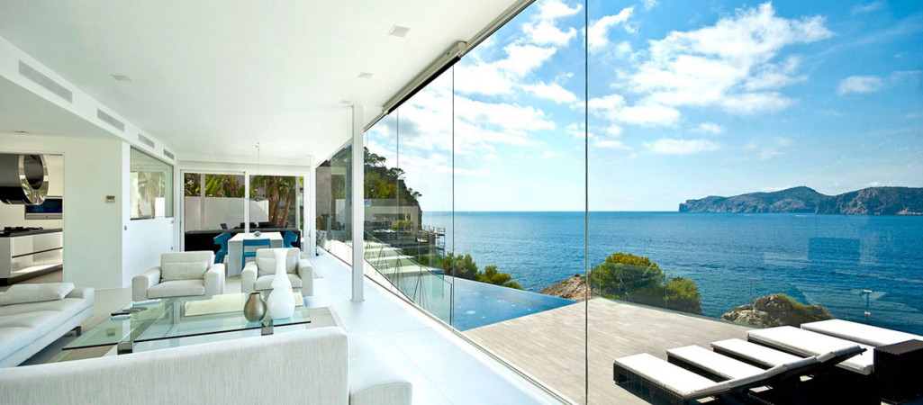 Would Buying This Glazed Waterfront Designer Villa Make You Happier?