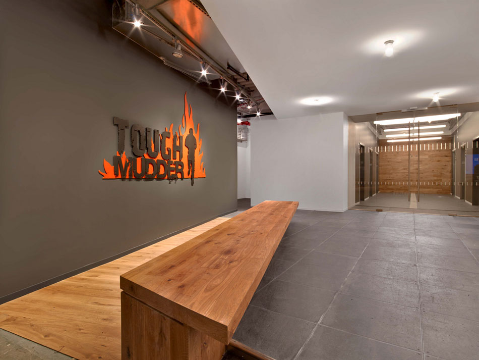 Tough Mudder Office raw and sophisticated design for tough mudder's brooklyn