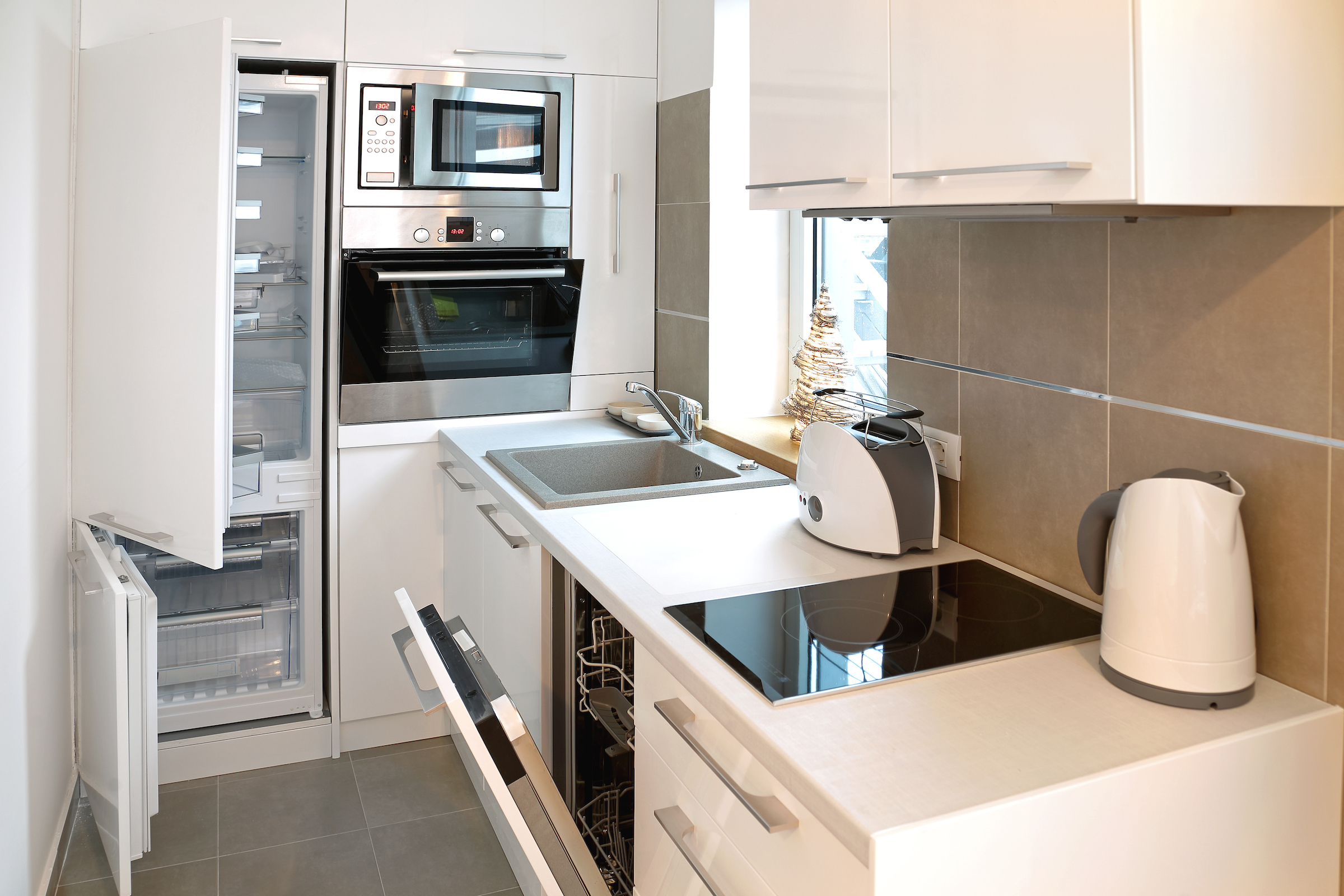 Everything is Open in Small Modern White Kitchen