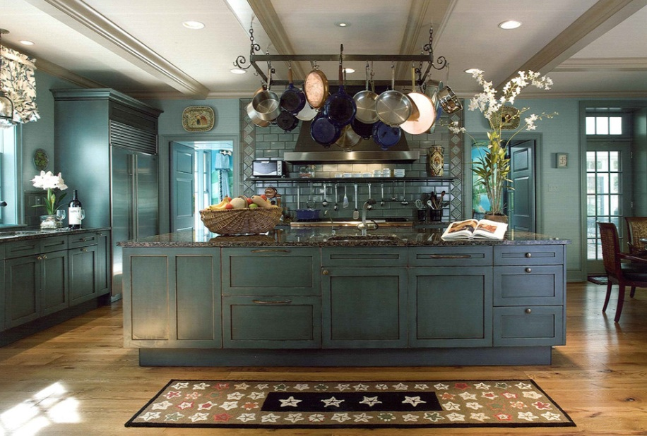 blue kitchen with pot rack