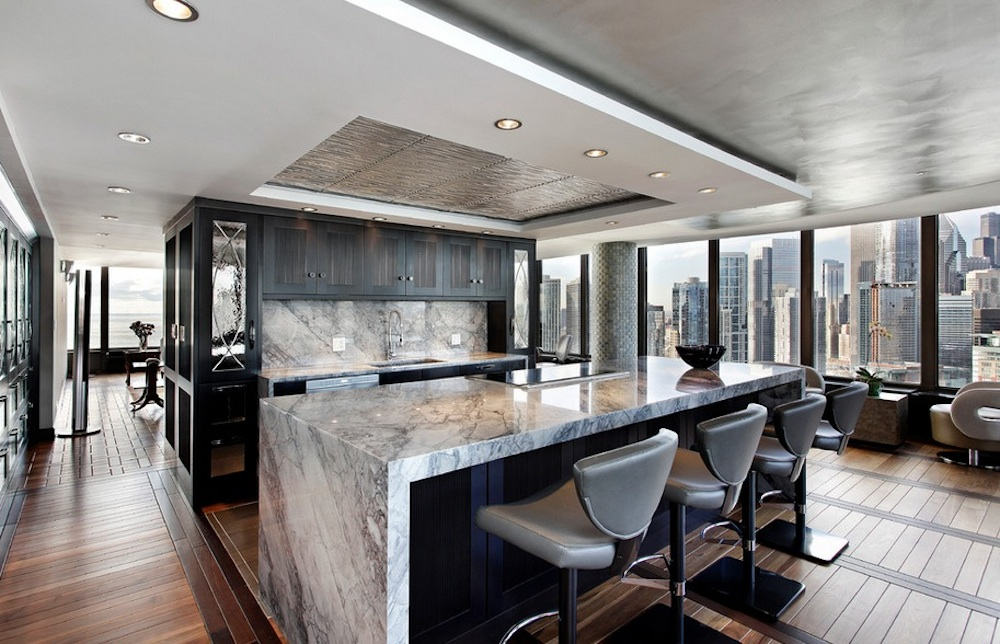 A marble island will give the room a sleek look. Image Via: Abruzzo Kitchen & Bath