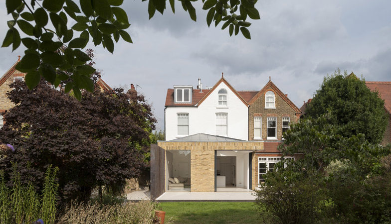 Interesting Home Extension in London Featuring Brick Walls and Sliding Glass Doors