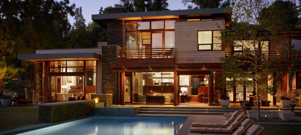 Refined, Functional and Open Family Home Design Nestled Between Trees