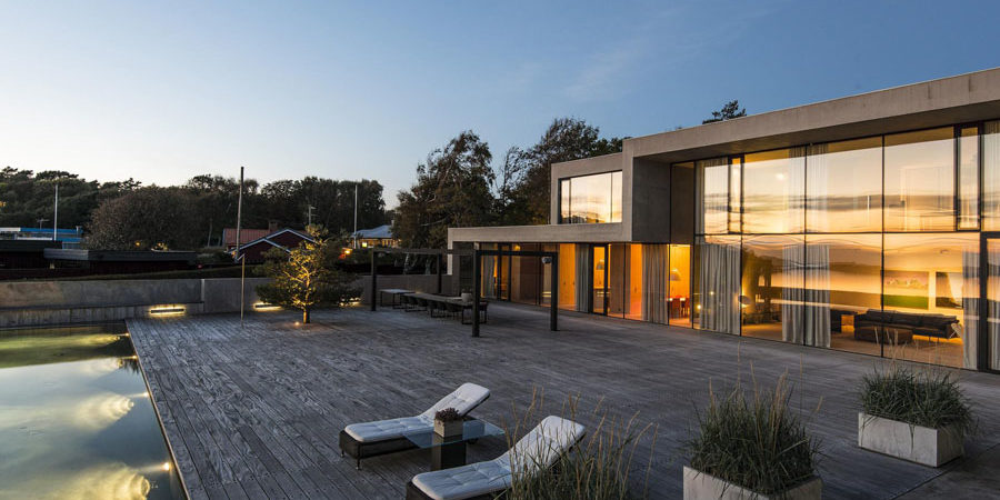 Modern Home in Sweden AccessingStunningSea Views and Rocky Hillscapes
