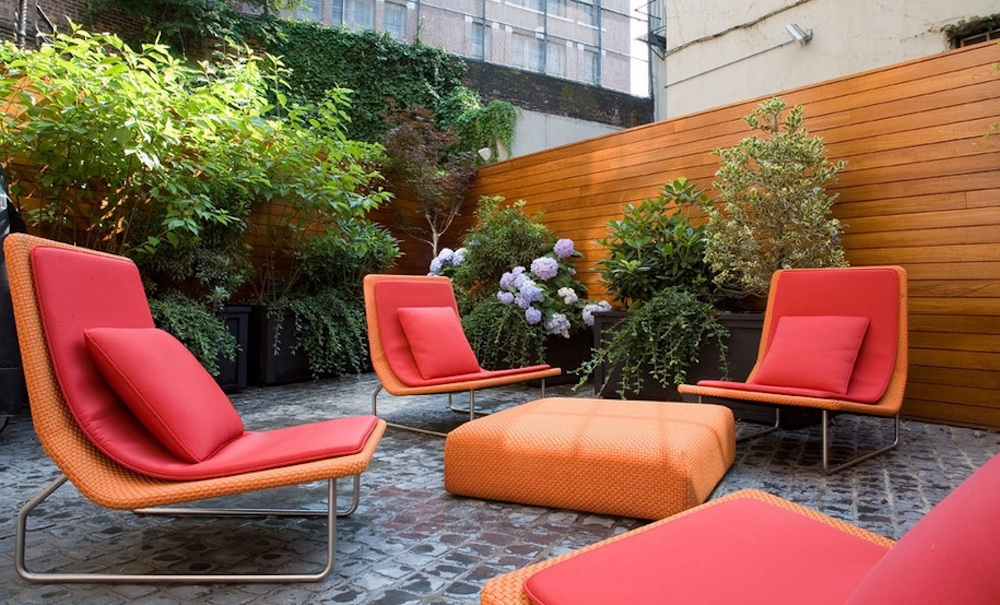 Use warm colors to encourage lively conversation. Image Via: Axis Mundi