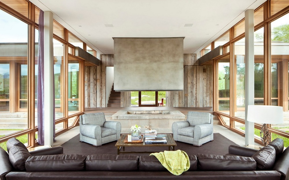 Before lighting a fire, clear the hearth of flammable objects. Image Via: Hughesumbanhowar Architects
