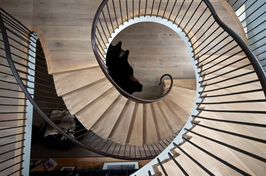 Massive Staircase Design Incorporating a Floor-to-Ceiling Bookcase
