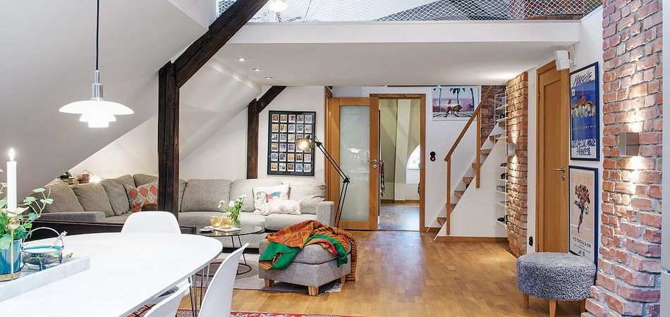 Joyful Attic Apartment Overlooking Colorful Roofs in Gothenburg, Sweden