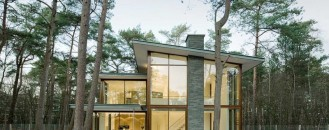 Modern Villa Kerckebosch Taking In A Forested Landscape in the Netherlands