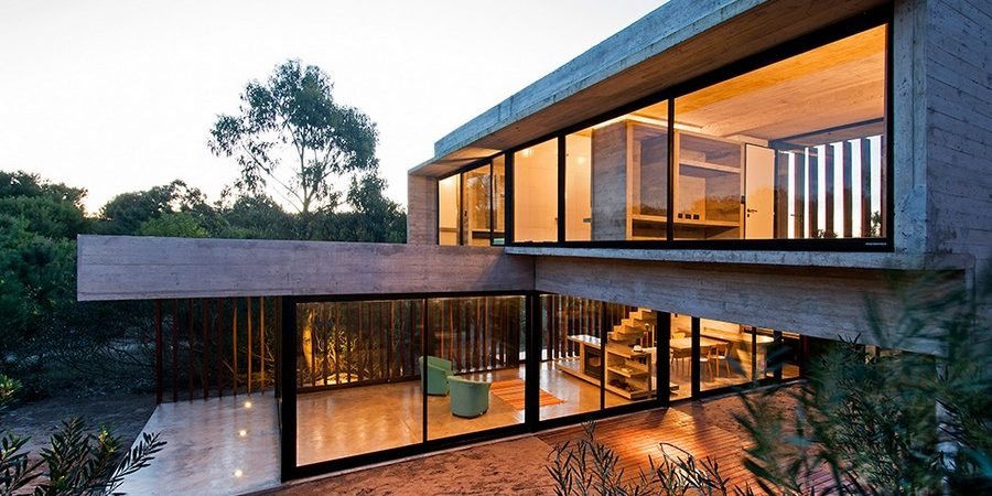 Concrete Holiday Retreat Partially Supported by a Sand Dune: Casa MR in Argentina