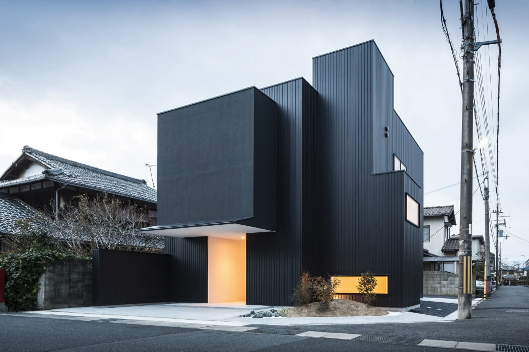 Distinct Black White Exterior Showcased By Minimalist Framing House