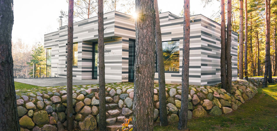 Modern River House in Lithuania Contrasting Natural Surroundings